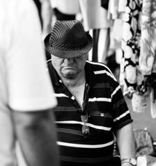Man With Hat (CoolMcFlash) Tags: man person candid bnw bw black white monochrome street streetphotography portrait canon eos 60d vienna hat mann wien sw schwarzweis blackandwhite strase hut fotografie photography face gesicht hidden versteckt tamron f004 90mm macro