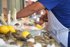 Shucking Clams (KaDeWeGirl) Tags: newyorkcity bronx belmont arthuravenue cosenzas fish market quitbeefingeatfish clams seafood