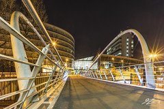 Run, Don't Walk (Tim van Zundert) Tags: hdr highdynamicrange manchester greatermanchester urban picadillystation bridge manchestercurve curvebridge tram lighttrail northwestengland architecture city night evening longexposure sony a7r voigtlander 21mm ultron