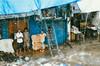 (Haruna Kawanabe) Tags: india nikon film mumbai slum dharavi rain poverty workers