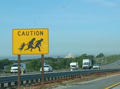 Caution fleeing family (haymarketrebel) Tags: nuclearpowerplant freeway traffic guardrail california sanonofrenucleargeneratingstation
