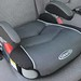 Graco backless booster seat in gray car