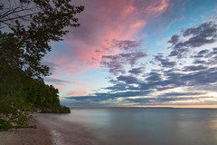 A Christmas Cove Sky (matthewkaz) Tags: christmascove christmascovebeach sunset sky clouds lakemichigan lake water reflection reflections puremichigan leelanau leelanaupeninsula summer greatlakes beach sand trees longexposure northport michigan 2017