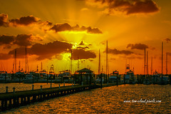Yellow and Orange Rays (tclaud2002) Tags: sun sunrisemsunrise rays colorful marina water river stlucieriver nature mothernature clouds cloudy sky weather morning stuart florida usa greatoutdoors boats sailboats
