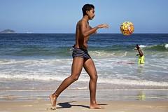 Football at Copacabana Beach (a l o b o s) Tags: guy playing jugando body beautiful alegre arena beach boys boy brasil brazil brazilian candid chicos copacabana cute de divertido enjoying fun garoto garotos having janeiro men man outdoors playa praia rio sand speedo sunga football