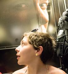 Under Surveillance (UrbanphotoZ) Tags: woman subway face shades earring overhershoulder advertisement turn starz strain shuttle timessquare westside midtown manhattan newyorkcity newyork nyc ny backpack