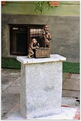 Monument to pharmacists (Ігор Кириловський) Tags: chernivtsi ukraine slr nikonf5 af zoomnikkor 28105mmf3545d film kodak colorplus200 promaster spectrum7uv ukrainskastr reissgasse monument pharmacist
