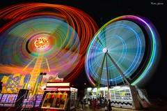 Colorful circles (Peideluo) Tags: light night colors long exposure larga exposicion circle people street spain feria fair nikon