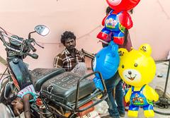 @Bhuvanagiri,Chidambaram. (Vijayaraj PS) Tags: red india asia nikond3200 streetphotography indianstreetphotography street tamilnadu light tradition village eyes people blue yellow baby sleeping man toy balloon
