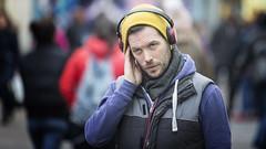 Tuned in (Frank Fullard) Tags: frankfullard fullard candid street portrait listen device mobile radio headphones yellow galway irish ireland hand ear