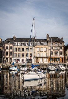 fine art colour impressions of a yacht preparing to leave Le Vieux Bassin (Old Harbour) in Honfleur, Calvados, Normandy, France