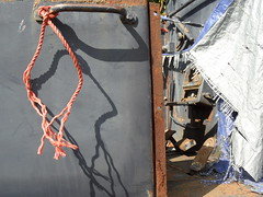 Repeat view (Nekoglyph) Tags: kirkleatham redcar museum cleveland teesside rnli tractor lifeboat blue rust metal old orange rope shadows sunlight pedals controls white tarpaulin