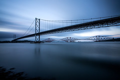 Bridge into the blue (GlasgowPhotoMan) Tags: forth firthofforth portedgar southqueensferry queensferrycrossing forthbridge forthrailbridge forthroadbridge suspensionbridge cantileverbridge bridge water sea ocean unesco unescoworldheritagesite edinburgh scotland bigstopper leefilters longexposure bluehour dusk concordians