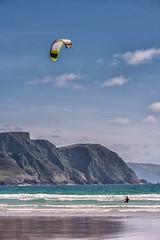 Kite surfing at Keel (mickreynolds) Tags: 2017 achill ireland mayo nx500 wildatlanticway kite surfing keel beach cliffs minaun blue sky