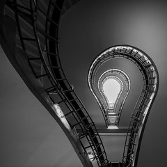 Bulb Mode (McQuaide Photography) Tags: prague praag praha czechrepublic českárepublika czechia centraleurope europe sony a7rii ilce7rm2 alpha mirrorless 1635mm sonyzeiss zeiss variotessar fullframe mcquaidephotography adobe photoshop lightroom handheld light architecture inside indoor interior building city capitalcity spiral spiralstaircase stairs staircase abstract pov lookingup up houseoftheblackmadonna czechmuseumofcubism oldtown staréměsto thehouseoftheblackmother učernématkyboží wideangle wideanglelens shape form swirl cubist cubism blackandwhite bw mono monochrome 11 square bulb lightbulb