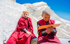 Don't Disturb Me !! I'm Studying.... (MOMENTmak3r) Tags: nikon nikkor spiti portrait lamaji lama young student red contrast mountains himalayas india winters sky monastery
