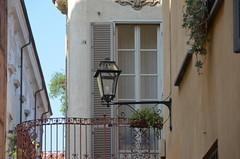 on the corner of the town (Hayashina) Tags: torino turin italy lamp window balcony