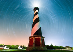 Star Trails at Cape Hatteras Light House (Robert Loe) Tags: capehatteras capehatteraslighthouse light illuminated glow star stars startrails milkyway grass northcarolina outerbanks obx beach island lightpainting lightcrafter image photo nightphotography night photography explore robertloe trees house blue clear landscape travel traveldestinations famousplace longexposure nikond810 big bright dynamic colorful atmosphere moody moodysky sky starrynight nightlandscape galaxy cosmos