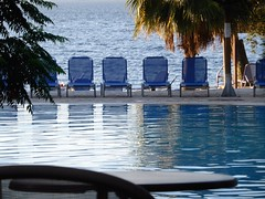 Blue Monday!!!P1020772 (amalia_mar) Tags: bluemonday floridabluebay psathopyrgos pool sea seats blue water summer greece 7dwf chairs