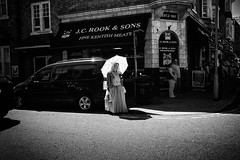 Time Travel (Fuji and I) Tags: street blackandwhite umbrella dickens broadstairs england fair alexarnaoudov fujix