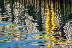 Wharf Abstract (Karen_Chappell) Tags: wharf dock pier reflection reflections water harbour ocean yellow blue ripples ripple abstract stjohns newfoundland nfld avalonpeninsula atlanticcanada canada pattern