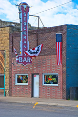 STOCKMAN'S BAR (akahawkeyefan) Tags: bar harlowton montana davemeyer flags bunting neon brick