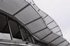 Wave Form (35mm) (jcbkk1956) Tags: shapes wave building roof canopy bangkok thailand thonglo mall mono blackwhite film 35mm analog pentax pentaxk2 ilford ilfordpan100 manualfocus 50mmf17 worldtrekker glass reflection architecture design