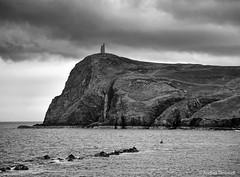 26 Face (manxmaid2000) Tags: face cliff braddahead porterin isleofman iom dark brooding tower monochrome landscape clouds
