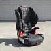 Britax child car booster seat in driveway