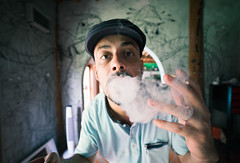 partly cloudy (polo.d) Tags: cloud smoke tobacco roll up portrait close hat indoor film look face male graffiti art