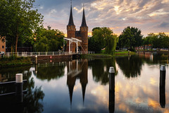 Oostpoort @ Delft (Marcel Tuit | www.marceltuit.nl) Tags: canon eos historic holland me marceltuit nederland oostpoort thenetherlands architecture architectuur bridge brigde brug city clouds contactmarceltuitnl delft gate historie history langeslutiertijd longexposure paal poort reflectie reflection stad sunset toren tower water wolken wwwmarceltuitnl zonsondergang