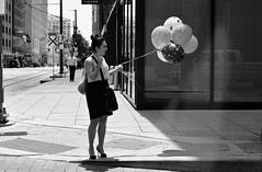 Fly Me With Balloons (burnt dirt) Tags: houston texas downtown city town street sidewalk crosswalk girl woman man couple crowd grouppeople person asian latina blonde brunette cute sexy laugh smile jeans dress skirt shorts yogapants tights leggings longhair shorthair ponytail heels stilettos boots shadow sunny reflection stockings friend lover pregnant athlete exercise glasses sunglasses phone cellphone construction traffic office building worker lunch streetphotography documentary portrait fujifilm xt1 bw blackandwhite tattoo metro bus busstop trainstop balloon
