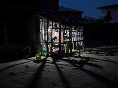 Nigerian trader is a beacon of light for customers (Keith Tomlins) Tags: night shot shadows trader nigeria abeokuta beacon light bucket wooden frame