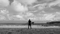 done surfing (SCRIBE photography) Tags: uk england dorset bournemouth sand beach sea ocean surf board surfer wave pier black white shore wetsuit clouds