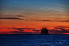 Goodnight Moon (The Shutter Affair) Tags: moon sunset grand haven grandhaven michigan lake shore beach orange sky lighthouse michiganlighthouse sliver goodnightmoon night photography nightsky