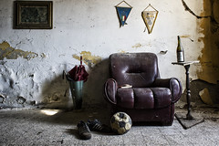 Kick Off (Giorgio Marra) Tags: urbex photography dust lost forgotten abandoned empty darkness contrast decay italy mansion old indoor dark light shadow echoes photo memories silence time armchair umbrella ball soccer shoes bottle past wall room canon