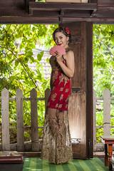 Girl in red dress (Akasumoto) Tags: girl portrait lighting indoor red body beautiful smoke heat vietnam eyes flower light blur bokeh look naive backgroud aodai hat makeup back door tree strobe