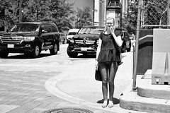 Squint (burnt dirt) Tags: houston texas downtown city town street sidewalk crosswalk girl woman man couple crowd grouppeople person asian latina blonde brunette cute sexy laugh smile jeans dress skirt shorts yogapants tights leggings longhair shorthair ponytail heels stilettos boots shadow sunny reflection stockings friend lover pregnant athlete exercise glasses sunglasses phone cellphone construction traffic office building worker lunch streetphotography documentary portrait fujifilm xt1 bw blackandwhite tattoo metro bus busstop trainstop