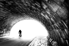 Light Tunnel (James- Burke) Tags: belgium blackandwhite bw candid candidcapture fleetingmoments fuji ghent monochrome street tunnels silhouette cyclist bridge samsung 12mm