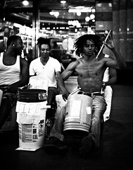 0246937080-90-Drumming on Fremont Street Las Vegas-5-Black and White (Jim There's things half in shadow and in light) Tags: 2017 america canon5dmarkiv fremontstreet lasvegas nevada streetphotography tamron45mmf18divc unitedstates downtown summer tourism travel drummer streetart busker blackandwhite men musician