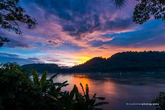 Sunset of Mekong River in Luang Prabang (reubenteo) Tags: sunset laos luangprabang mekong river mountain hill cloud sun sunlight twilight bluehour goldenhour riverfront asia southeastasia boat travel vacation quiet tranquil blue warm orange phousi