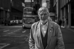 Veteran (Leanne Boulton) Tags: urban street candid portrait portraiture streetphotography candidstreetphotography candidportrait streetportrait eyecontact candideyecontact streetlife man male old veteran face facial expression look emotion feeling beard silver hair sunlight tone texture detail depthoffield bokeh naturallight outdoor light shade shadow city scene human life living humanity society culture people canon canon5d 5dmkiii 70mm character ef2470mmf28liiusm black white blackwhite bw mono blackandwhite monochrome glasgow scotland uk