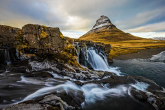 Kirkjufell with Clouds (jm.weeden) Tags: iceland kirkjufell mountain waterfall water spring ice cold blue orange yellow summer clouds sunset dusk landscape photographer picoftheday likeforlike followforfollow snow sky artist digital canon texture nature green art artsy light sun river scenery bright camera colors rocks colorful countryside ciel contrast country europe travel eos long exposure longexposure