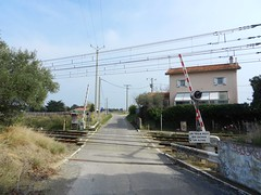 Railway Crossing (sander_sloots) Tags: railway crossing france power lines barriers montpellier spoorwegovergang spoorlijn frankrijk sncf electricity poles pylons slagbomen