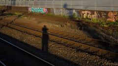 Photographer at work (frankdorgathen) Tags: outdoor nordrheinwestfalen ruhrgebiet essen mainstation hauptbahnhof sunset light shadow sun graffiti iron steel railway train