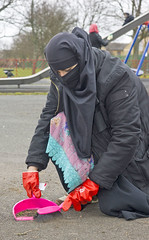 Playground clear up (Aisha Niqabi) Tags: niqab hijabi gloves rubber red maid cleaning domestica