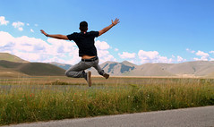 Freedom (alessandroliga) Tags: free llibertà spazio moutain grass jump salto man sky clouds italy flying way route alone street upland air