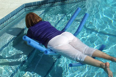 Trying (clarkfred33) Tags: balance float pool water wet wetadventure whitepants wetpants wetfun noodle wetclothes wetlook wetwoman swim poolfun