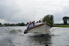 Women on a powerboat (Edwin Verhulst) Tags: women ladies powerboat boat sloep maas roermond oolderhuuske limburg netherlands cloudy daylight fun smile