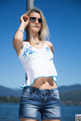 Eye-catching view (tnekralc) Tags: eyecatching view model laura cute sexy lake woman shorts tshirt face sunglasses blonde hair arm hand belly navel mouth lips